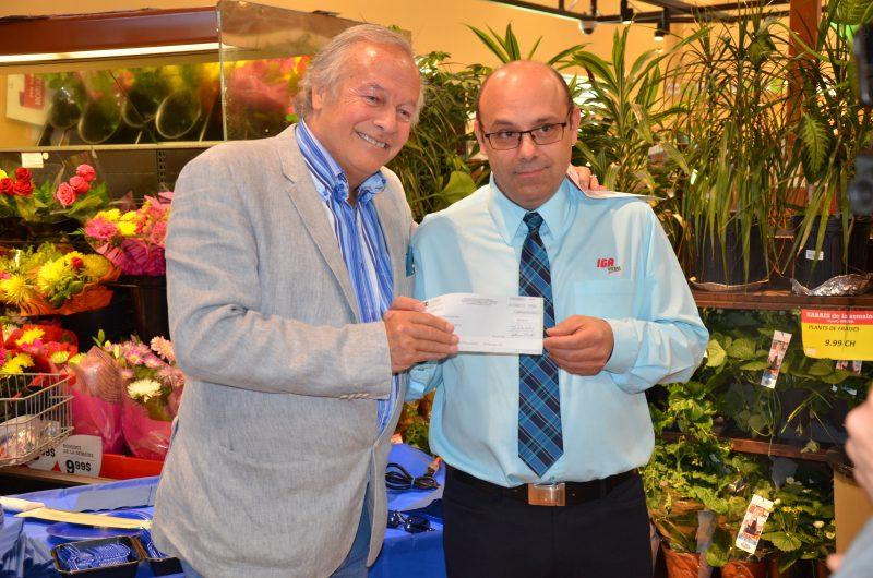 Loto-Québec a remis un chèque de 500 000$ au propriétaire du IGA extra André Tellier. | TC Média - Sarah-Eve Charland