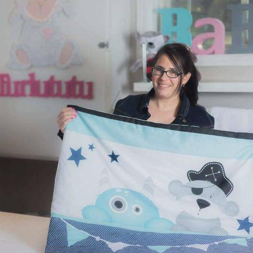 Mélanie Auclair possède une boutique de décoration pour bébés et enfants et crée des douillettes et couvertures personnalisées.  Photo gracieuseté